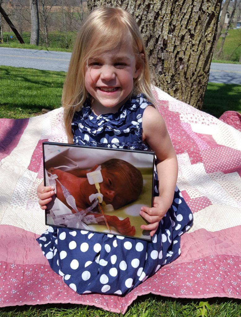 Lydia with her newborn photo